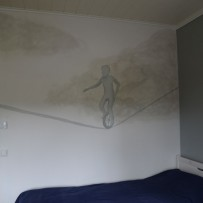 Seinämaalaus: Yksipyöräilijä